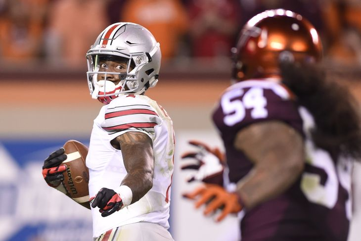 Braxton+Miller+goes+video+game+mode+on+a+Virginia+Tech+defender